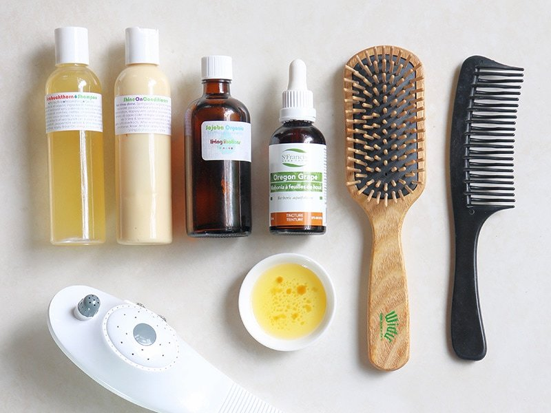 A scalp treatment for acne prone skin using oregon grape extract, jojoba oil, Widu wooden brush, and haircare products from Living Libations.