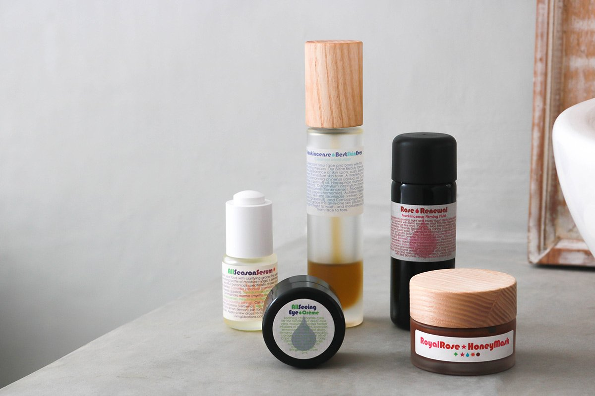 Living Libations review featuring Frankincense Best Skin Ever, Rose Renewal + Frankincense Firming Fluid, All Season Serum, All Seeing Eye Creme, and Royal Rose Honey Mask.