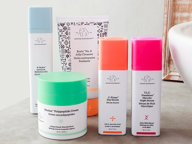 Review of Drunk Elephant products featuring C-Firma, Protini Polypeptide Cream, T.L.C. Framboos Glycolic Night Serum, Beste No.9 Jelly Cleanser, and B-Hydra.